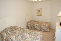 Bedroom 5 with two twin beds and TV/DVD